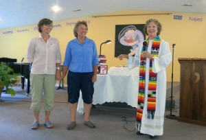 HCUCC Interim Pastor Nancy Sehested leads the congregation in blessing members Linda and Chris who married in Delaware Aug 30, 2013.